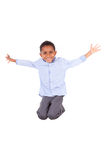 African American little boy jumping  - Black people. African American little boy jumping, isolated on white background - Black people Stock Photo
