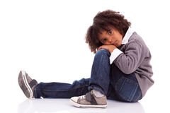 African american little boy sitting on the floor Royalty Free Stock Photos