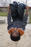 African American little boy on a slide. Royalty Free Stock Images