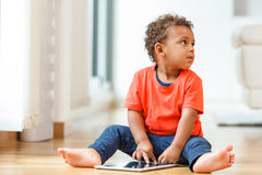 African american little boy using a tactile tablet Stock Photography