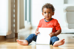 African american little boy using a tactile tablet Royalty Free Stock Images