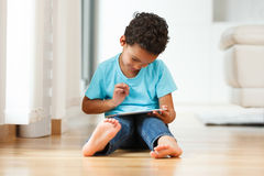 African american little boy using a tactile tablet Stock Image