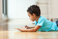 African american little boy using a tactile tablet Stock Photos