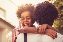 In father hug. African American little girl in fathers hug. Looking at camera. Close up royalty free stock images