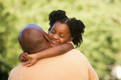 African American father and his daughter. African American little girl hugging her father Stock Photography