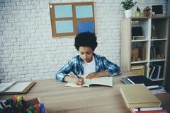 African American little preschooler doing homework royalty free stock image