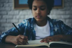 African American little preschooler doing homework royalty free stock photography