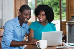 African american love couple shopping at web Stock Photos