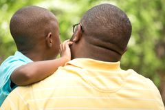 Father talking to his son. African American loving father guiding his son Stock Images