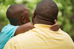 Father talking to his son. African American loving father guiding his son Stock Image