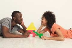 African-american lying on floor at new apartment Stock Photography