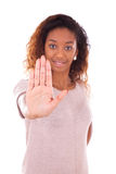 African american making stop sign with her hand palm isolated on Stock Photos