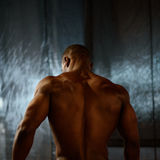 African american male body builder posing on a studio background. Back view Stock Photo