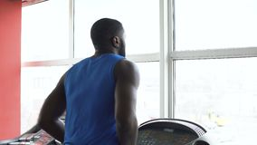 African-American male boxer running on treadmill and exercising in the gym. Stock footage stock footage
