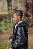 African american male child playing outdoors. African american boy playing outdoors in autumn Royalty Free Stock Photos
