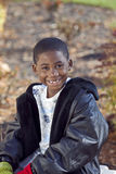 African american male child playing outdoors. African american boy outdoor autumn portrait Stock Photo