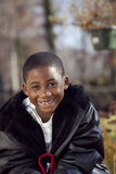 African american male child playing outdoors. African american boy outdoor autumn portrait smiling Royalty Free Stock Photos