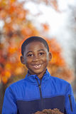 African american male child playing outdoors. African american boy outdoor autumn portrait smiling with copy space Royalty Free Stock Photo
