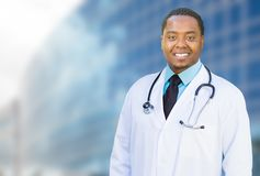 African American Male Doctor Outside of Hospital Building Royalty Free Stock Images