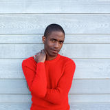 African american male fashion model in red sweater. Portrait of african american male fashion model in red sweater Stock Photos
