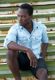 African american male fashion model sitting on stairs Stock Images