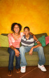 African-American male and female on couch Royalty Free Stock Images