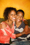 African-American male and female on couch Stock Photography