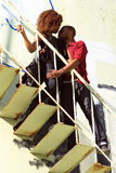 African-American male & female on stair stock photos