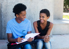 African american male and female student learning for exam Royalty Free Stock Photos