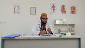 African american male medical worker prescribing pills and filling in form stock video footage