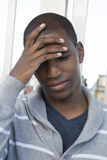 African American male model hand on head thinking or pondering Stock Photo