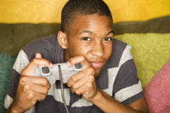 African-american male playing video games. Handsome young man Playing a Video Game with Handheld Controller Stock Images