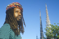 African American male poses with the Watts Towers, 20th Anniversary of the 1965 riots, Los Angeles, California Royalty Free Stock Photo