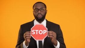 African-american male showing stop sign, antiracism campaign, social equality. Stock footage stock footage