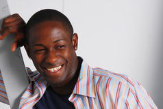 African american male smile. Muscular male african american laughing and looking away in colorful outfit Stock Photos