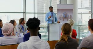 African american male speaker speaking in a business seminar 4k. Front view of an African american male speaker speaking to the public in a business seminar 4k stock video