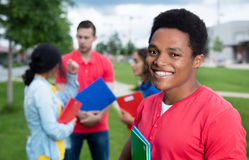 African american male student and multiethnic friends Stock Images