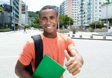 African american male student showing thumb in city. Outdoor in the city in the summer Stock Photography