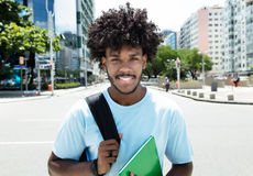 African american male student with typical hairstyle in city. Outdoor in the city in the summer Royalty Free Stock Images