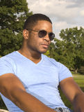 African American Male with Sunglasses leaning back Royalty Free Stock Photo