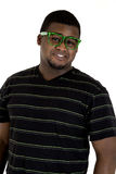 African American male wearing nerdy green glasses smiling Royalty Free Stock Image