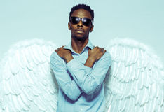 African American man with angel wings in sunglasses Royalty Free Stock Photos