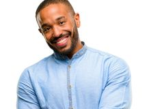 African young man isolated over white background. African american man with beard confident and happy with a big natural smile laughing isolated over white royalty free stock images