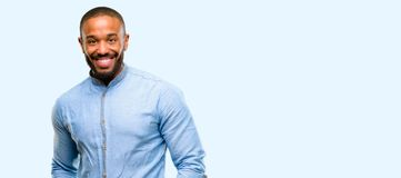 African young man over white background. African american man with beard confident and happy with a big natural smile laughing over blue background royalty free stock images