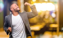 African young man  over white background. African american man with beard happy and excited celebrating victory expressing big success, power, energy and Stock Image