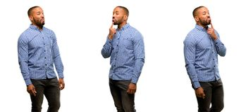 African young man isolated over white background. African american man with beard having skeptical and dissatisfied look expressing Distrust, skepticism and stock image