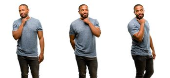 African young man isolated over white background. African american man with beard thinking thoughtful with smart face, expressing question and doubt. Imagine the Stock Image
