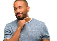 African young man isolated over white background. African american man with beard thinking thoughtful with smart face, expressing question and doubt. Imagine the Royalty Free Stock Photos