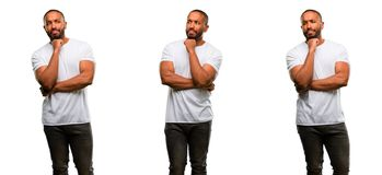 African young man isolated over white background. African american man with beard thinking thoughtful with smart face Stock Photo