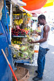 African American man buys coconuts Royalty Free Stock Images
